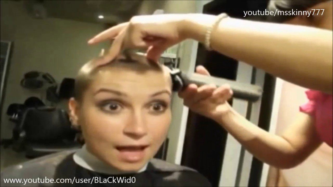 Video of woman getting head shaved