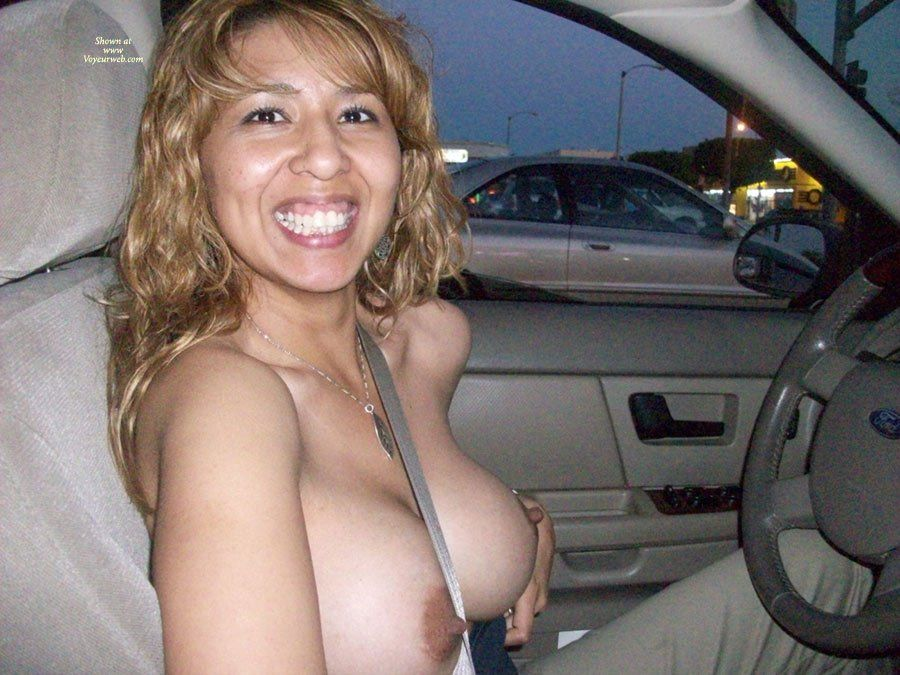 Nude driving with big boobs