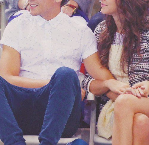 His hand on her leg